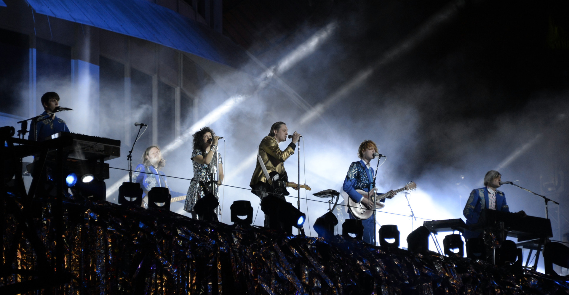 Indie rock band Arcade Fire performs at the Capitol Records building in Hollywood